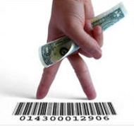Conceptual Image of a Hand Holding a Dollar Bill and Bar-code